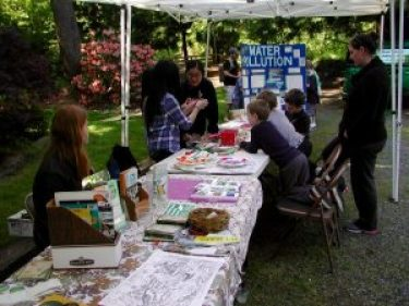 Members of Meadowdale High School's Environmental Club work with children on crafts projects during the 2015 Watershed Fair.