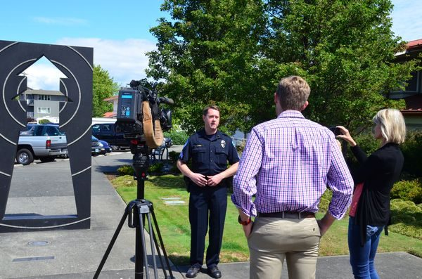 Edmonds police spokesman Sgt. Shane Hawley conducts a media briefing outside the Public Safety Complex Saturday. (Photo by Larry Vogel)