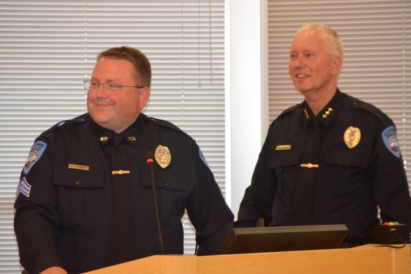 Newly promoted Sgt. Alan Hardwick turns to family and friends who came to support him during his swearing-in ceremony at Tuesday's Edmonds City Council meeting. Standing next to Hardwick is Police Chief Al Compaan.