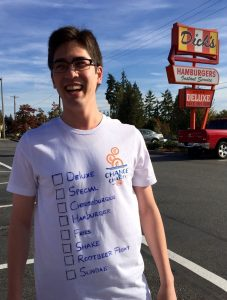 Walker Kevin Drake last year at the Edmonds starting line with his customized Dick's shirt, displaying a checklist of menu items that he'll consume during the walk. (Photo courtesy Lars Phillips)