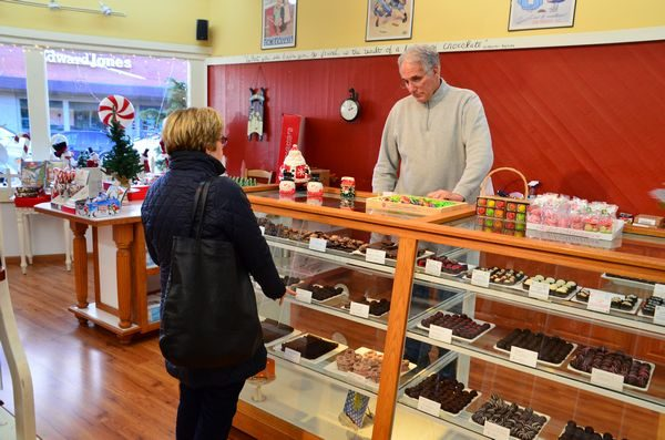 Nama's Candy owner Pat McKee assists a customer.
