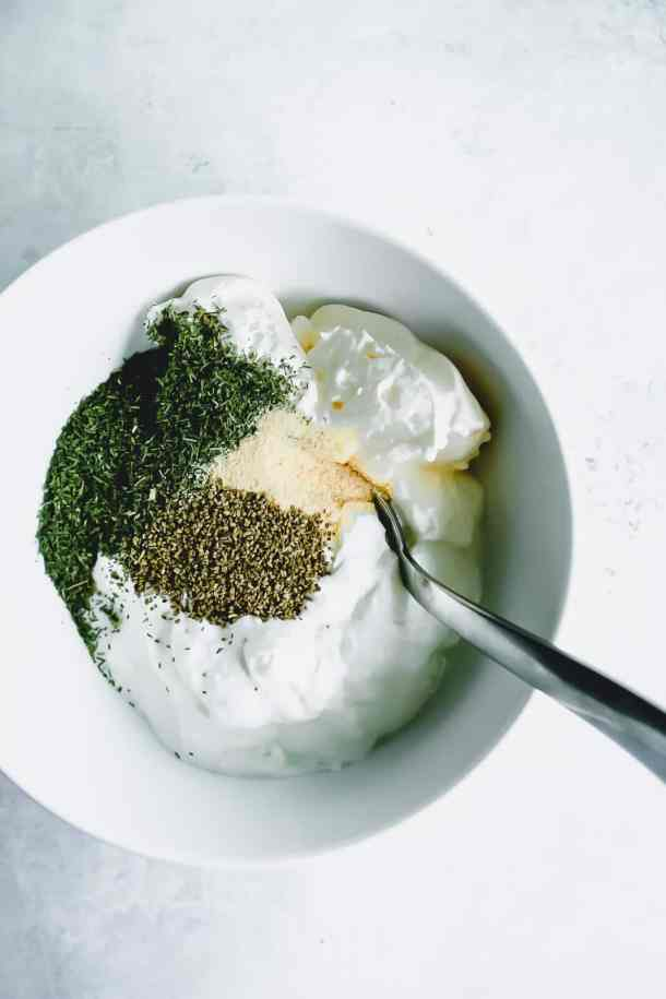 ingredients in a bowl for greek yogurt dip dill