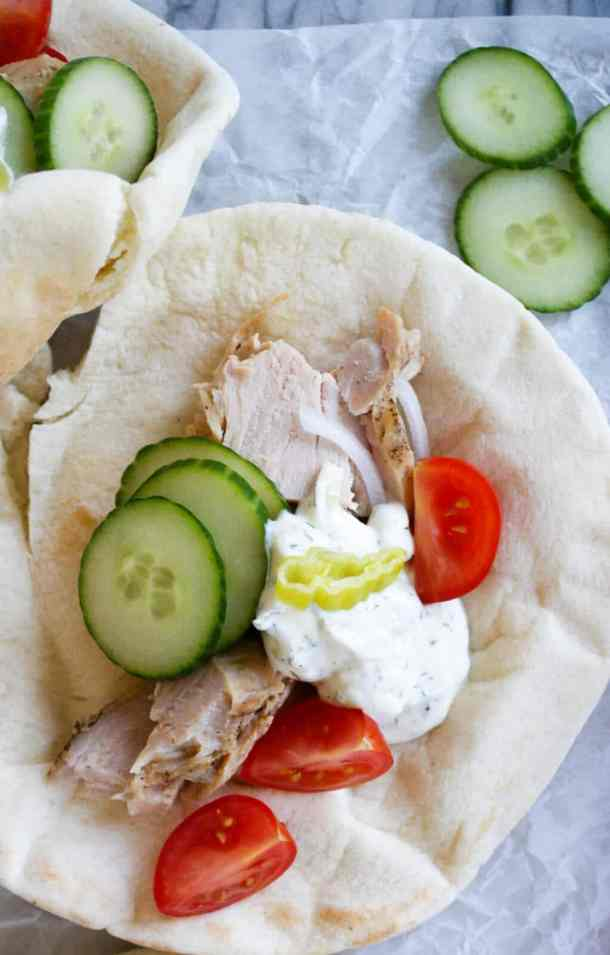 pork gyros on pita bread with toppings