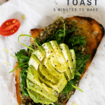 healthy avocado toast with pesto and tomatoes