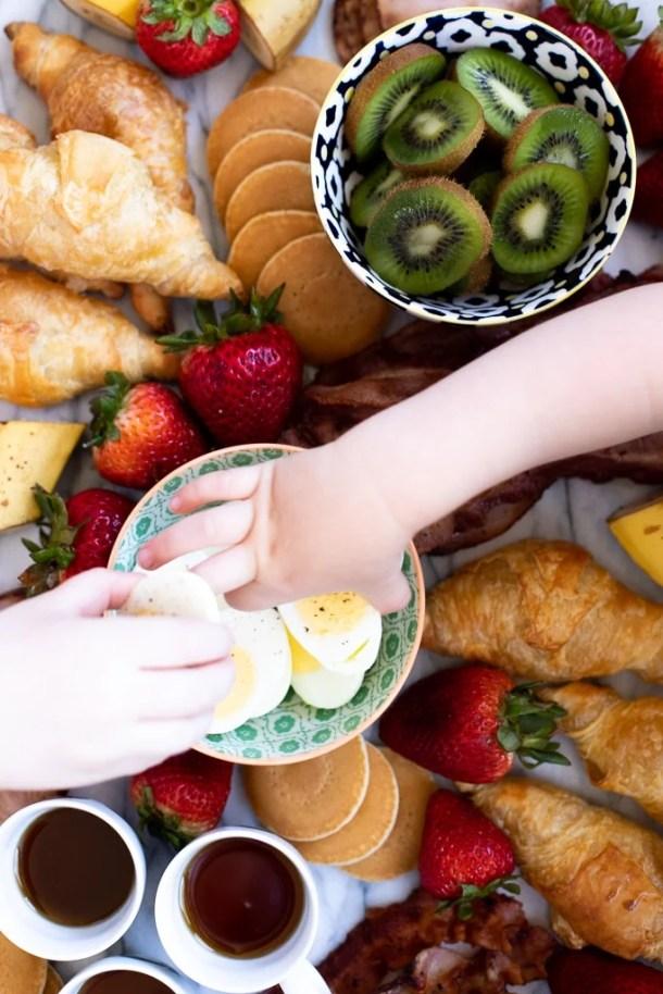 kids eating a breakfast spread