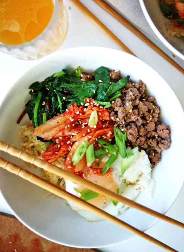 Easy Bibimbap Bowls | loaded with flavor: crispy rice, tasty ground beef, pungent kimchee and luscious fried eggs!