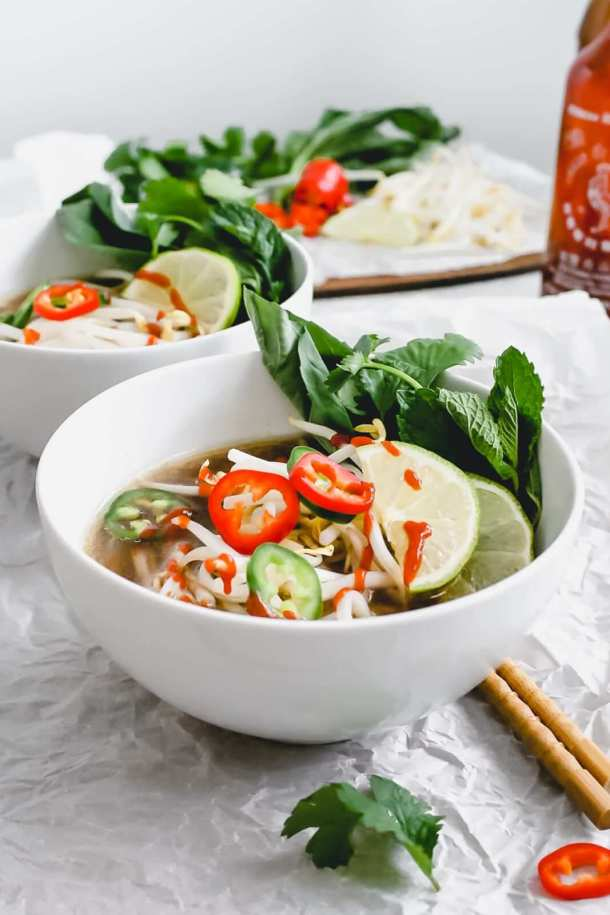 bowls of chicken pho noodle soup