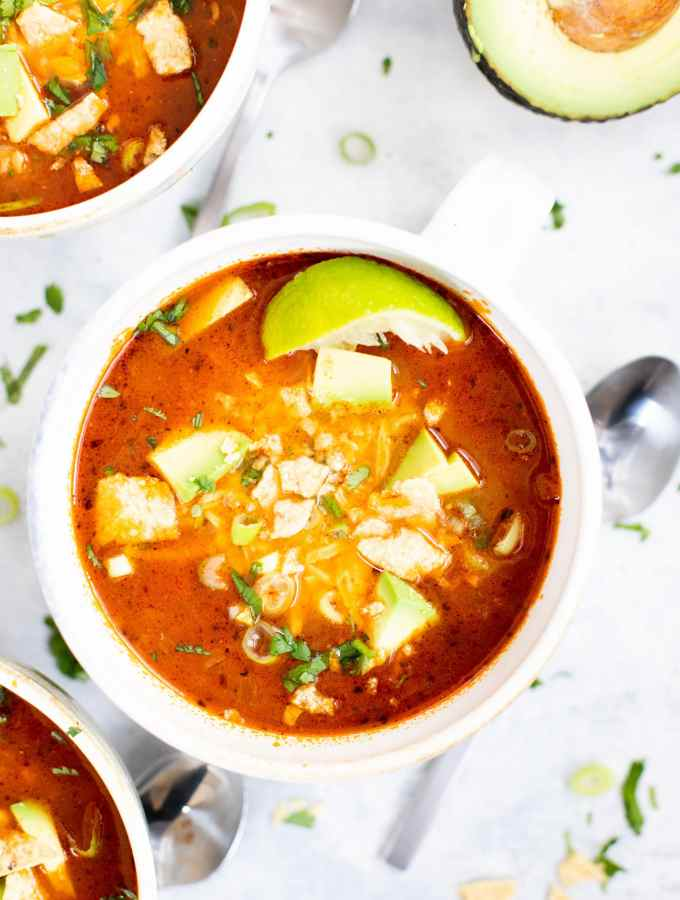 bowl of easy chicken taco soup with toppings and spoon