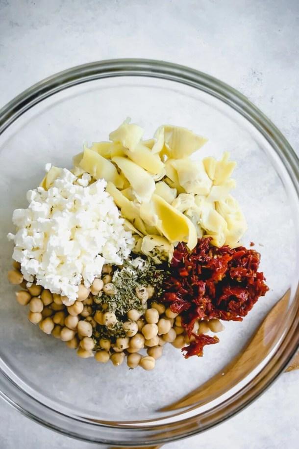 garbanzo bean salad ingredients in a bowl