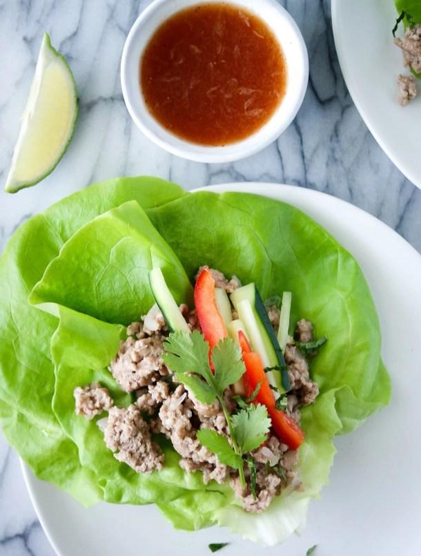 thai pork lettuce wraps on lettuce leaves