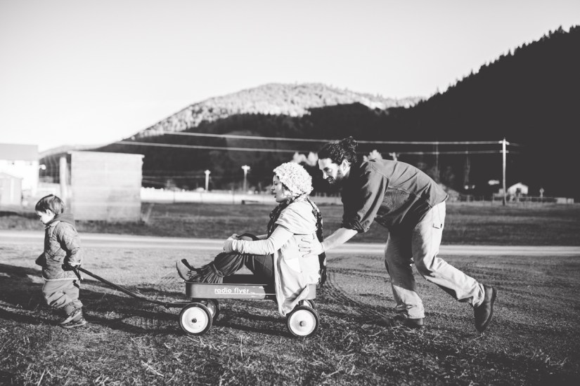 Outdoors Maternity Son Mother Father Together Playing Red Wagon Missoula Photographer
