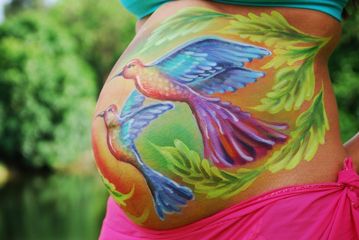 Pregnant belly painting hummingbirds