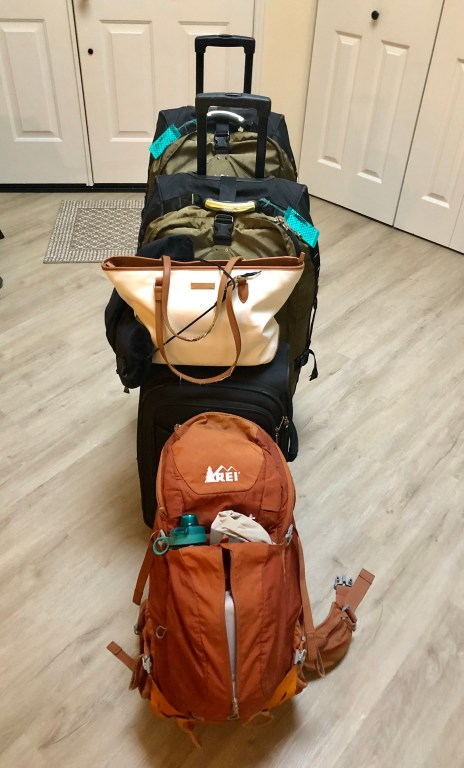 REI roller bags and backpacks
