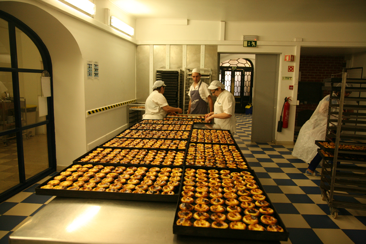 The Portuguese egg tarts being sorted out for the customers.