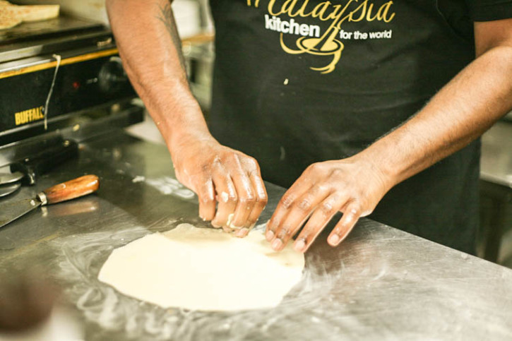 This food article describes the Roti King preparing the Malaysian Food Speciality roti canai for this travel blog.