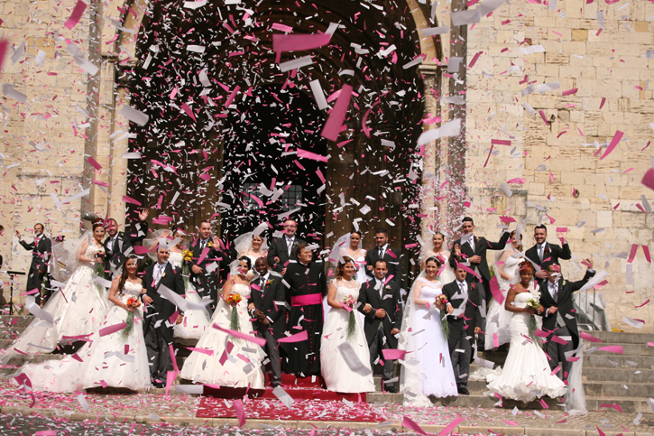 Eleven Happy couples with a spray of confetti