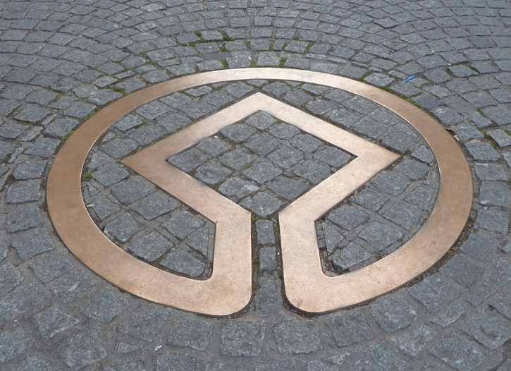 Symbol of a UNESCO World Heritage site on Stall Street, near the Entrance to the Roman Baths.