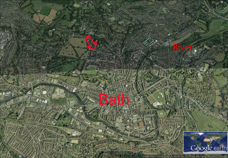 A Google Earth Image of the City of Bath. The River Avon which is marked out in Green, flows from the top right (North East) to the left (West). The City is at the bottom of a valley and the River Avon embraces the City on 3 sides. The hills are on the 4th side. The energy flows down the hill to the City (large red arrow).