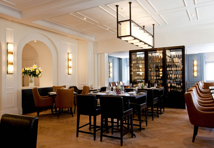 "The Restaurant at the Gainsborough Bath Spa. The Restaurant is divided by the Wine Wall with a ""private"" area behind it."