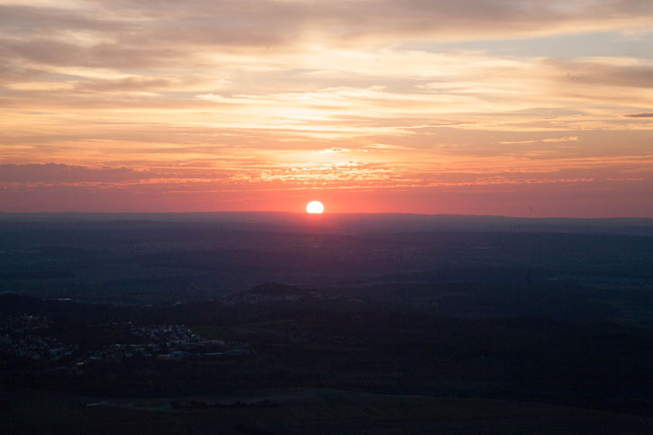 The Sunset over Neuffen Town (the faint speckes in the foreground). The image was taken from Neuffen Castle