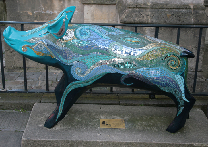 Statues of Pigs can be found in various locations in the City.