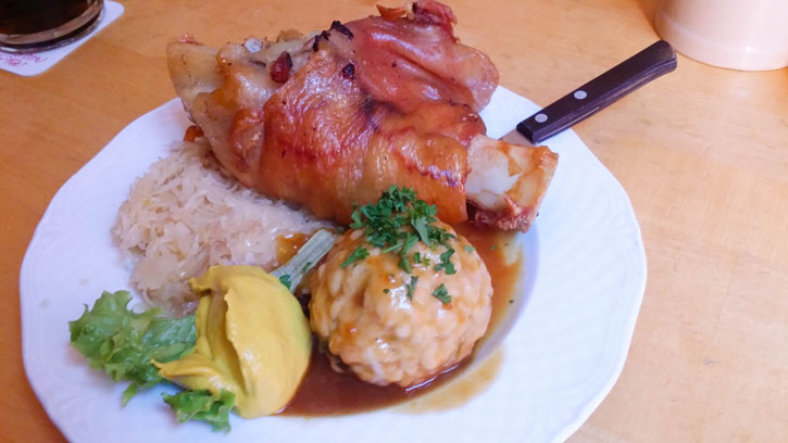 The Pork Knuckle with sauerkraut, dumpling with a spoonful of mustard.