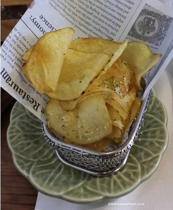 Mercearia Gadanha Restaurant : Freshly fried Potato Crisps sprinkled with herbs and sea salt served on culinary newspaper in a mini fryer.