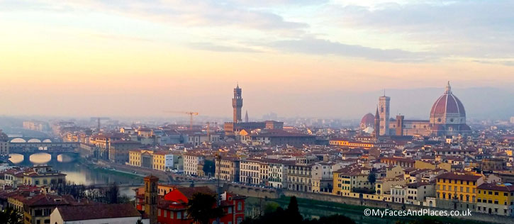 The Florence Cityscape bathed in the hazy golden glow of sunset