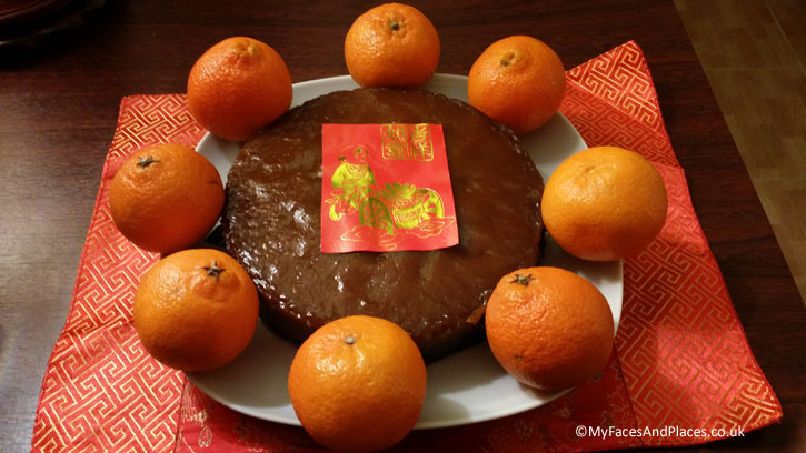 A Tee Kway cake decorated with oranges.