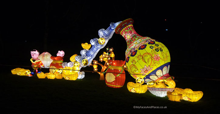 Magical Lantern Festival - Everlasting fortune flowing from the Wealth Vase. The symbols of prosperity are around the Vase - Gold coins, Gold nuggets etc.