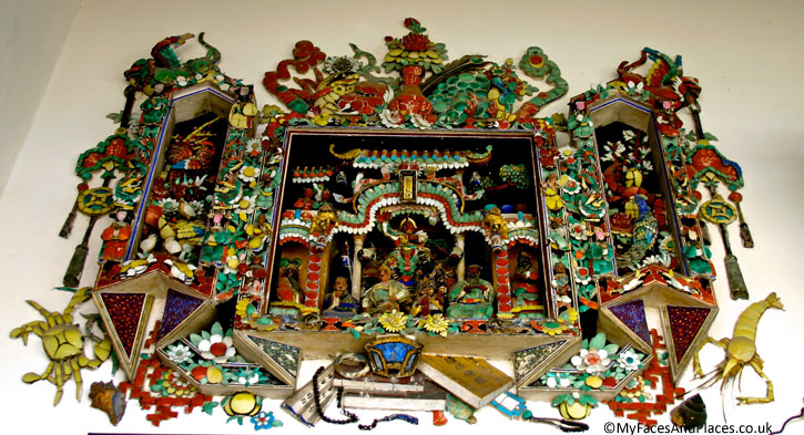 An example of the many fine ceramic friezes placed around the Blue Mansion in George Town, Penang.