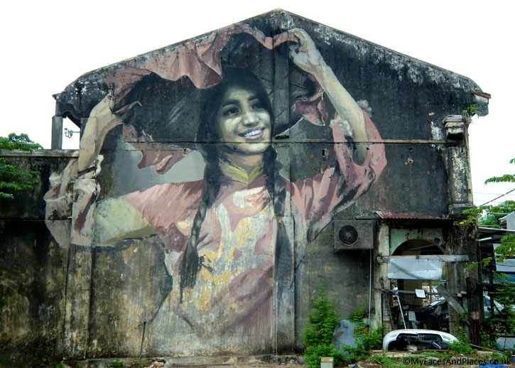 """""""The Hakka Dancing Girl"""". Julia was mesmerised by the photograph of Pang Yi Chuen doing a """"merry twirl"""" in a Hakka traditional dance. She painted it on the walls in this pre-dominantly Hakka village."""