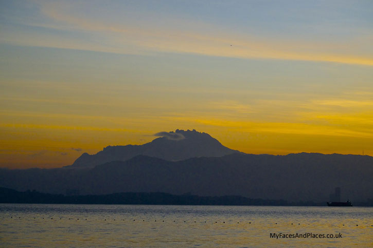 Gaya Island Resort - Sunrise reveals the majestic Mount Kinabalu in all its glory