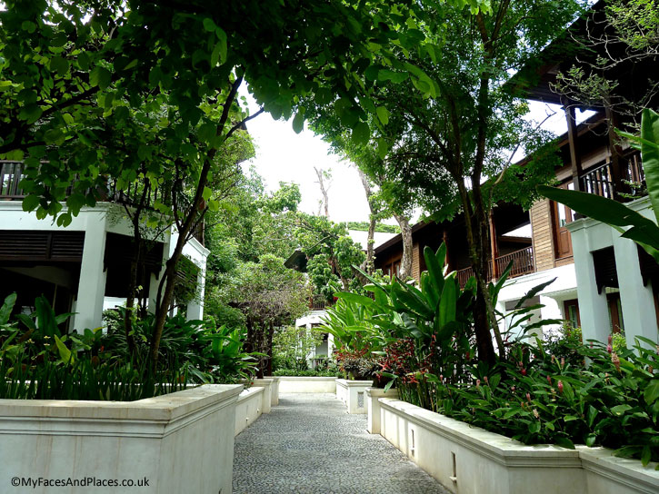 The amazing landscaped garden festooned with tropical plants and flowers in 137 Pillars House