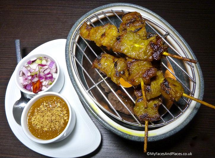 Satay presented on mini grill on the table - Ladyboys and Mango Tree Restaurant