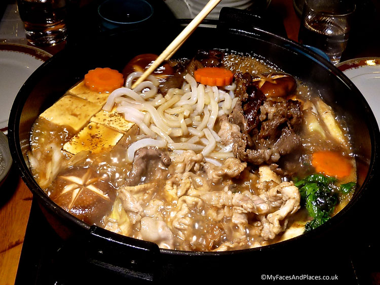 A steaming hot-pot of sukiyaki, the perfect warming dish for autumn and winter - autumn in Niseko