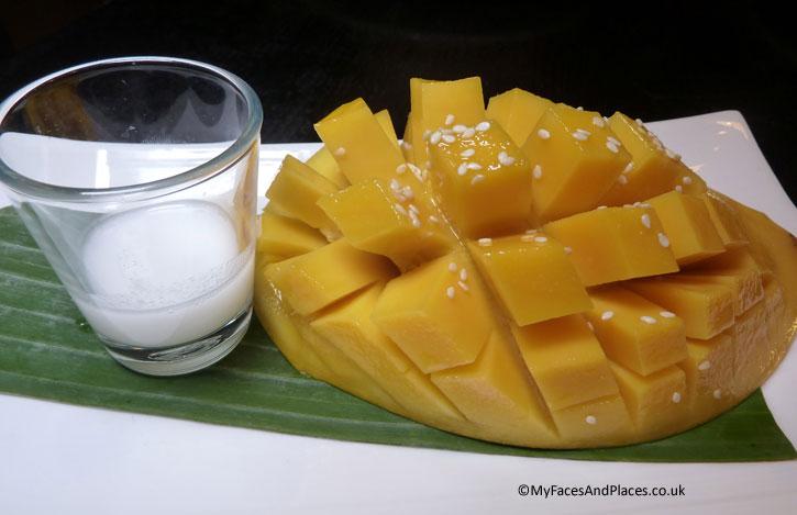 Sweet juicy Thai mango with coconut milk sauce