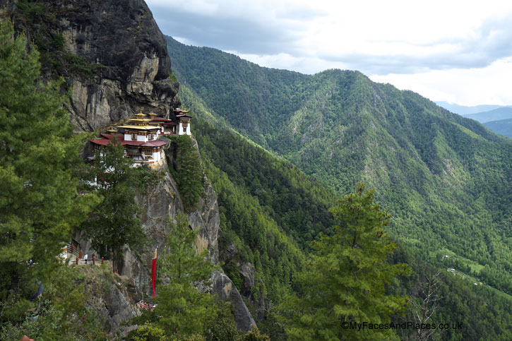 The awesome vista of Tiger's Nest overlooking a stunning pine-clad valley - Bhutan Tiger's Nest