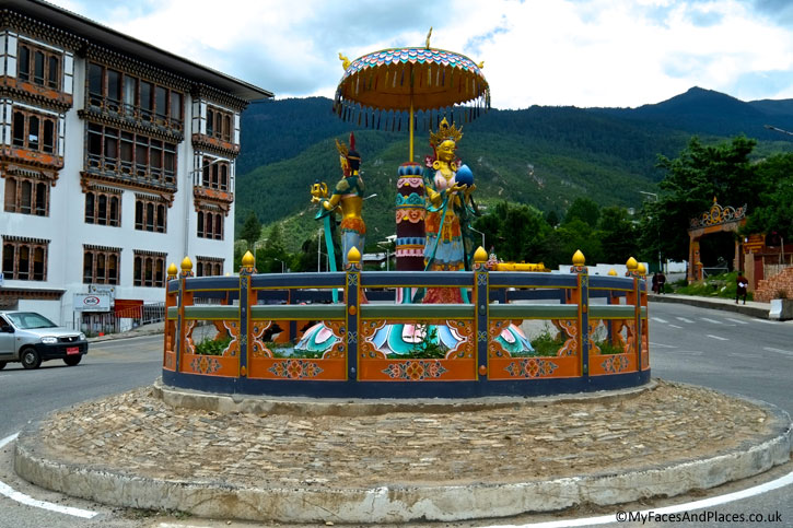 Goddesses in a pavilion grace the mini roundabout in Thimphu - Bhutan the Beautiful