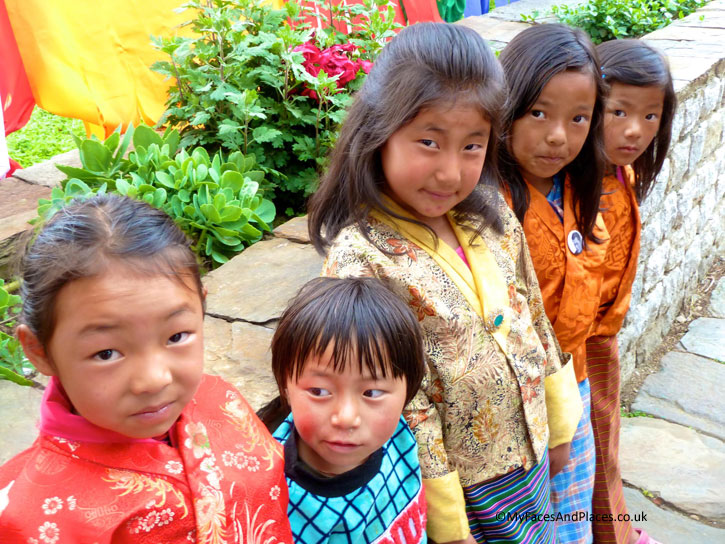 Children in their traditional attire attending a religious ceremony in Jakar - Bhutan the Beautiful