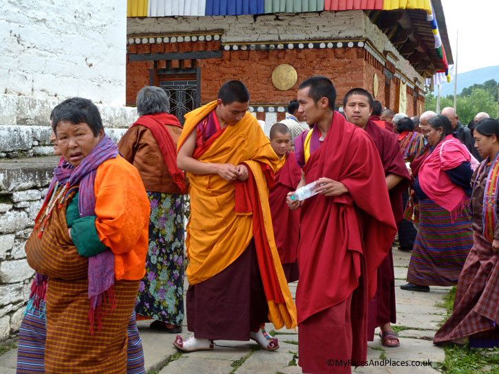 Worshippers in colourful national costumes at the Jambay Lhakhang for a religious ceremony - Bhutan the Beautiful
