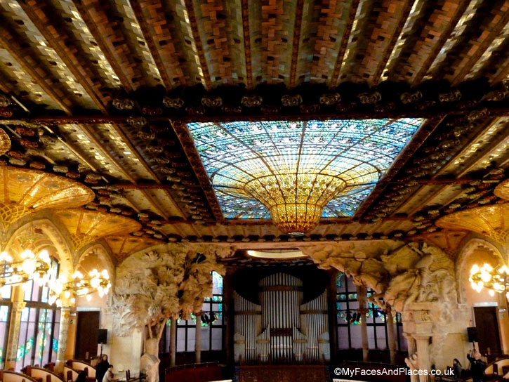 The splendid stained glass skylight of the Palau de la Musica Catalan in Barcelona, Spain