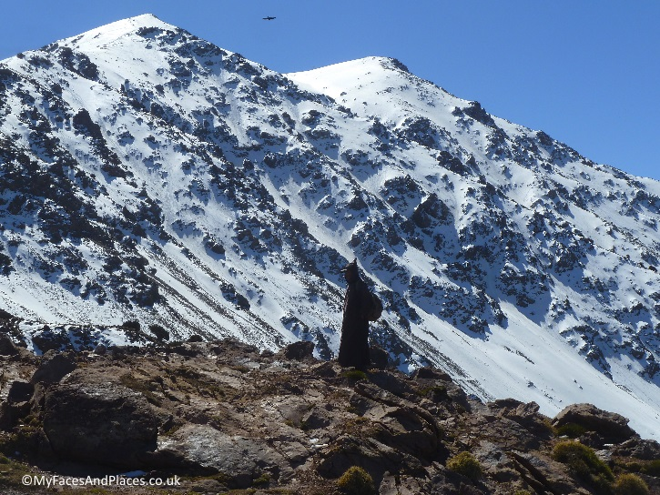 A lone Berber among the stunning view of the snow-clad peaks