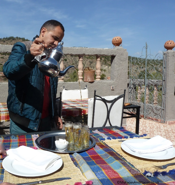 """Our guide pouring mint tea known locally as """" Berber Whisky"""" in a Moroccan style"""