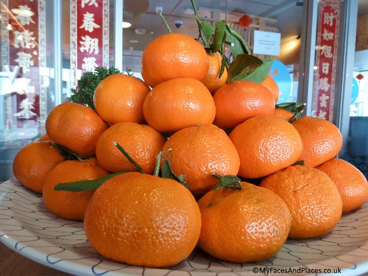 """Oranges for """"gold"""" and good fortune"""