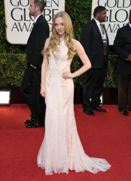 In a Givenchy Haute Couture by Riccardo Tisci gown. Amanda opts for subtle and sexy.