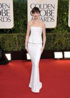 Wearing Chanel, Anne Hathaway rocked her pixie cut and slender frame.