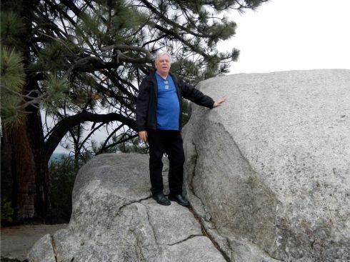 Fat guy on a boulder