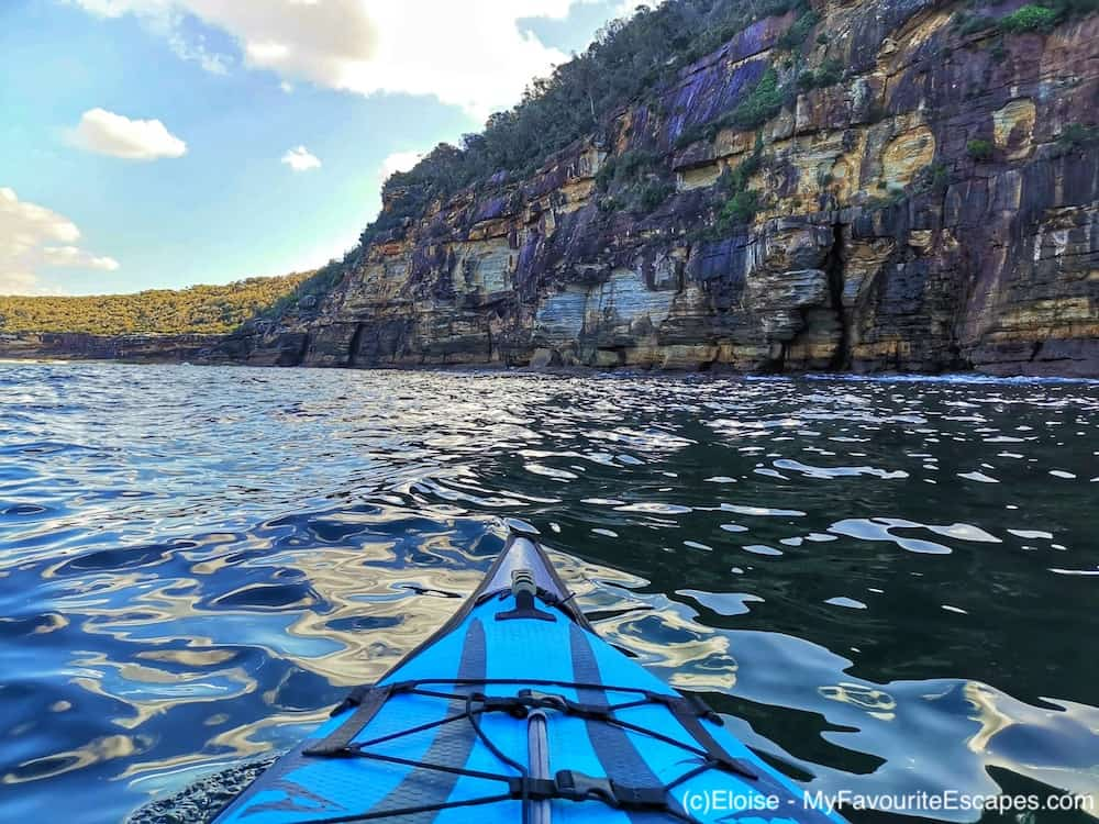 Kayak in front of beautiful cliffs in Manly North Harbour