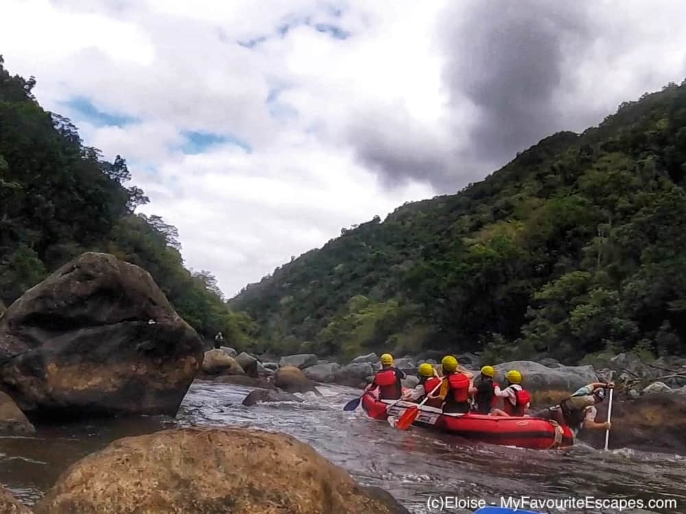 Group of six people on an inflatable raft going down the Barron River near Cairns